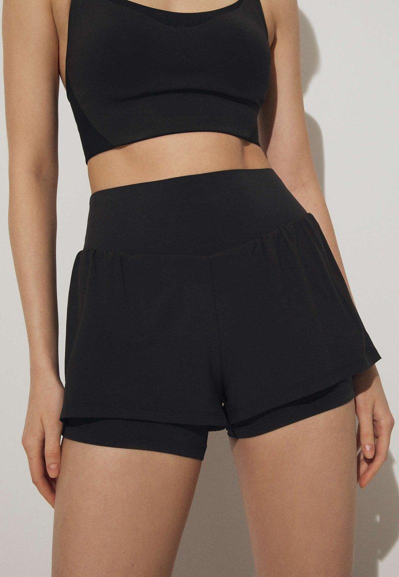 OYSHO - Sports shorts - black