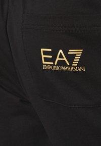 EA7 Emporio Armani - Trainingsbroek - black/gold - 5