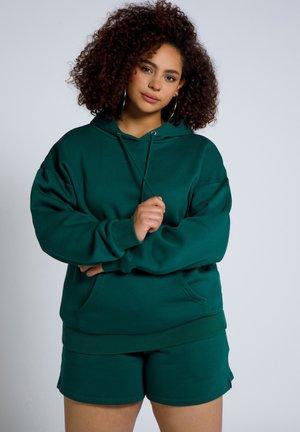 Huppari - dunkel smaragd