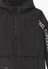 SuperRebel - SUSTAINABLE FASHION SPORTY PLAIN UNISEX - Snowboard jacket - black - 4