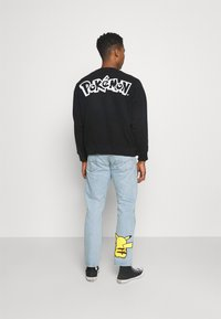 Levi's® - LEVI'S® X  POKÉMON UNISEX CREW - Sweatshirt - yellows/oranges - 2