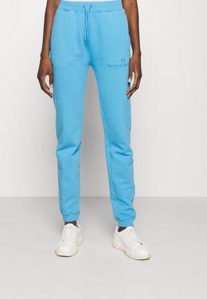 AMANDA PANTS - Tracksuit bottoms - azure blue