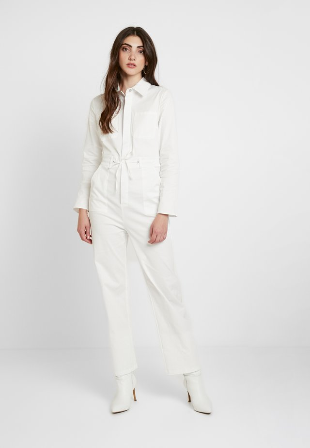 LONG SLEEVE BOILERSUIT WITH BUTTON FRONT AND SELF TIE BELT - Jumpsuit - white