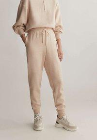 OYSHO_SPORT - Pantalon de survêtement - mottled beige - 0