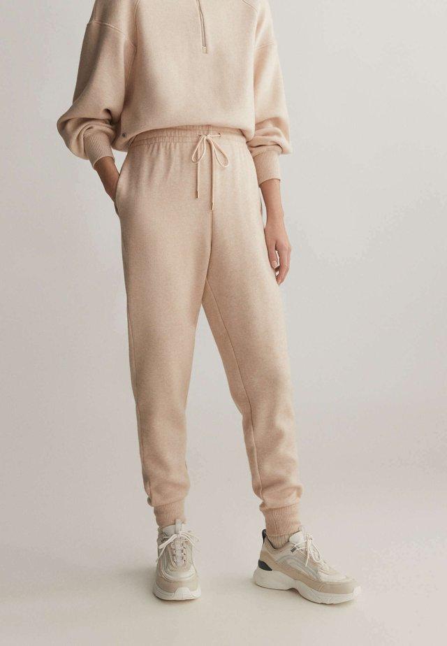 Spodnie treningowe - mottled beige