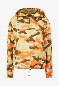 LADIES CAMO PULL OVER  - Waterproof jacket - olive