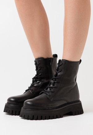 FLORENCE - Platform ankle boots - black