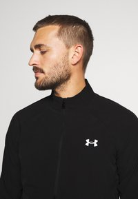 Under Armour - LAUNCH 3.0 STORM JACKET - Veste de running - black/black/reflective