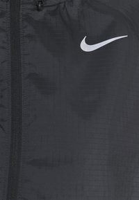 Nike Performance - RUN JACKET - Sports jacket - black/silver - 2