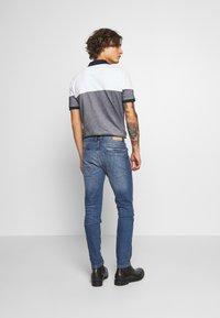 Burton Menswear London - ORGANIC - Slim fit jeans - mid blue - 2
