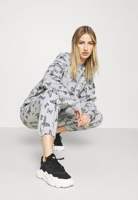 NEW girl ORDER - ACID BUTTERFLY JOGGER - Tracksuit bottoms - grey - 3