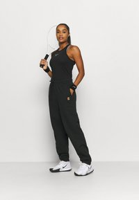 Nike Performance - HERITAGE PANT - Tracksuit bottoms - black - 1