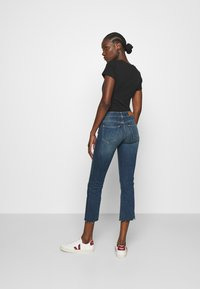 Replay - FAABY FLARE CROP PANTS - Slim fit jeans - medium blue - 2