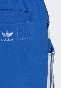 adidas Originals - NINJA PANT UNISEX - Tracksuit bottoms - blue - 6