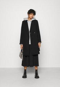 Vero Moda - VMCALAHOPE JACKET - Short coat - black - 1