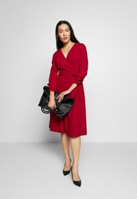 DKNY - RUCHED COVERED BUTTON SLEEVE FAUX WRAP FIT & FLARE - Jersey dress - scarlet - 1