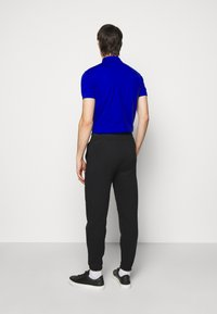 Polo Ralph Lauren - Tracksuit bottoms - polo black - 2
