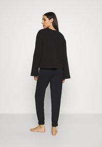 Calvin Klein Underwear - PERFECTLY FIT FLEX JOGGER - Pyjama bottoms - black - 2