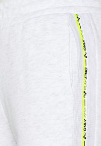 ONLY PLAY Tall - ONPALYSSA PANTS  - Tracksuit bottoms - white melange/safety yellow - 5