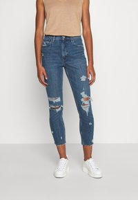Abercrombie & Fitch - MOM JEANS - Slim fit jeans - dark wash with destroy - 0