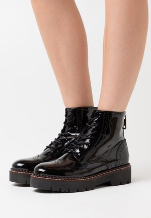 OLIVINE - Kotníkové boty na platformě - black