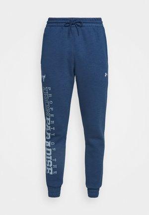 ROCK  - Pantalones deportivos - blue