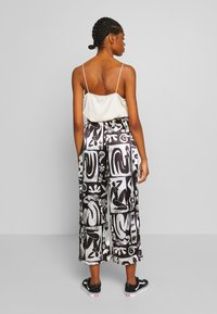 NEW girl ORDER - ABSTRACT TROUSERS - Spodnie materiałowe - black/white - 2