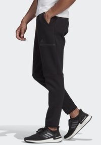 adidas Performance - Z.N.E. SPORTSWEAR PRIMEGREEN PANTS - Tracksuit bottoms - black - 1