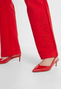 Escada Sport - TEHEART TROUSER - Tracksuit bottoms - red - 4