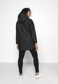 Vero Moda Curve - VMMALOU COATED - Waterproof jacket - black - 2