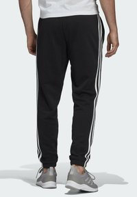 adidas Performance - ESSENTIALS FRENCH TERRY TAPERED 3-STRIPES JOGGERS - Pantalones deportivos - black - 1
