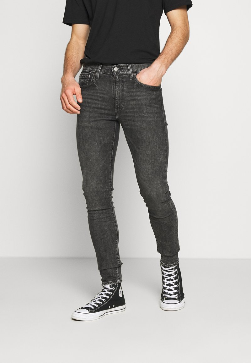 Levi's® - SKINNY TAPER - Vaqueros pitillo - black denim