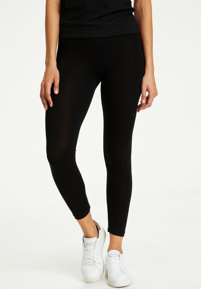 KAGILA  - Leggings - Trousers - black deep