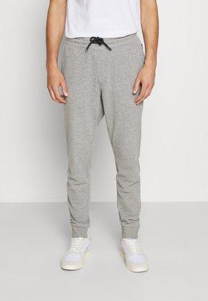 PANTS - Tracksuit bottoms - medium grey