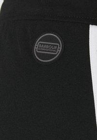 Barbour International - LUNAR TROUSER - Tracksuit bottoms - black - 8