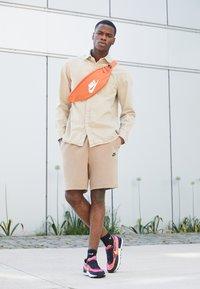 Nike Sportswear - WAFFLE ONE - Sneaker low - active fuchsia/univ gold-black-coconut milk-mtlc silver-orange - 1