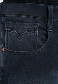 Replay - HYPERFLEX + ANBASS - Slim fit jeans - blue/black denim - 3