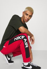 Nike Sportswear - AIR - Tracksuit bottoms - university red/black/white - 4