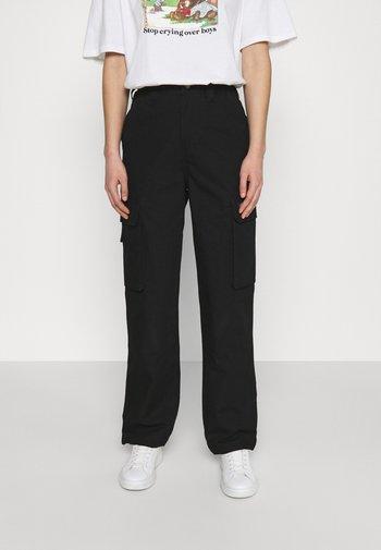 COMBA ELASTICATED - Pantaloni cargo - black