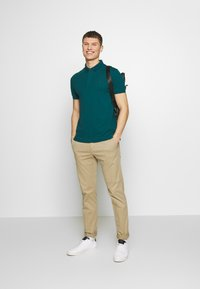 Lacoste - Polo shirt - mottled dark green