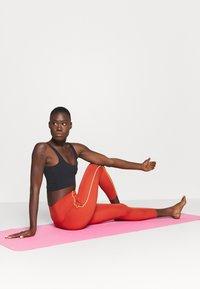 Nike Performance - YOGA CORE 7/8 VINT VINYASA - Tights - firewood orange/claystone red - 1