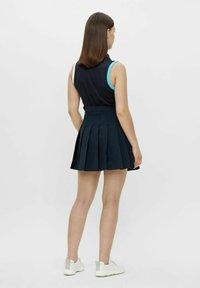 J.LINDEBERG - ADINA - Sports skirt - jl navy - 2