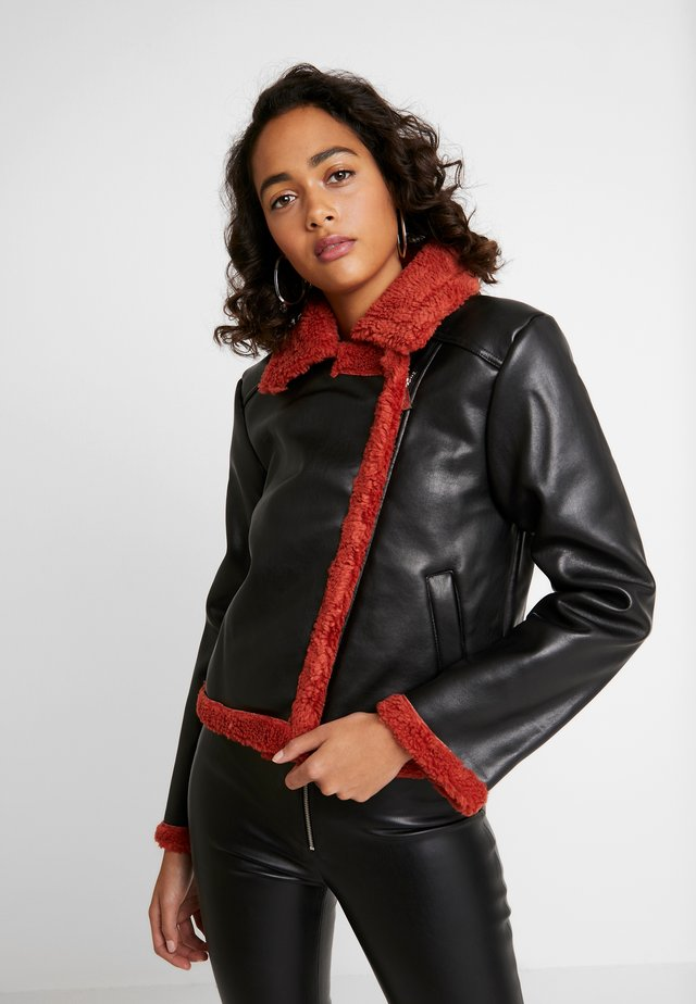 JACKET - Faux leather jacket - black/burnt red