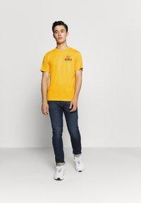 Diesel - T-JUST-N41 T-SHIRT - Print T-shirt - yellow - 1