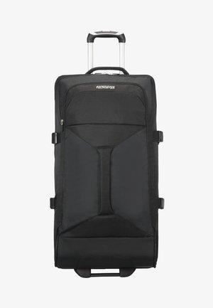 MIT ROLLEN - Luggage - solid black