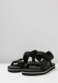 Slydes - NEVIS - Pantofle - black/white - 2