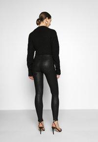 Vila - VICOMMIT  - Trousers - black/glitter - 2