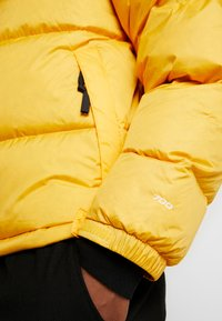 The North Face - Down jacket - yellow - 3
