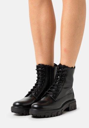 AXEL BOOTIE - Stivali da neve  - black