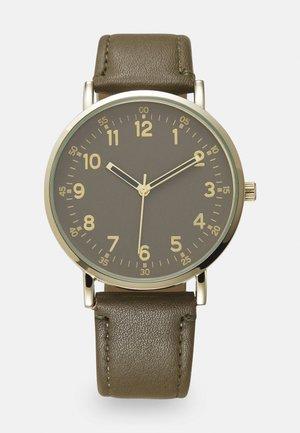 Klocka - olive